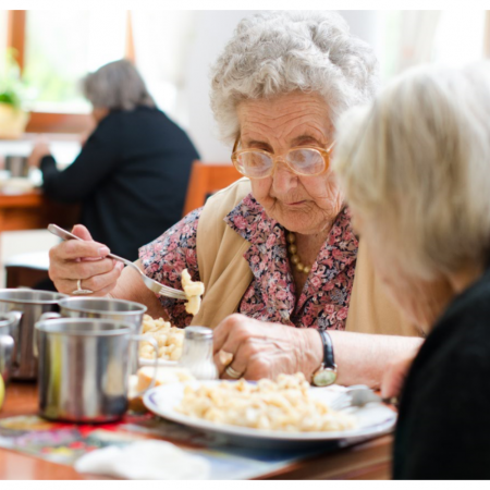 senior women eating in cafeteria