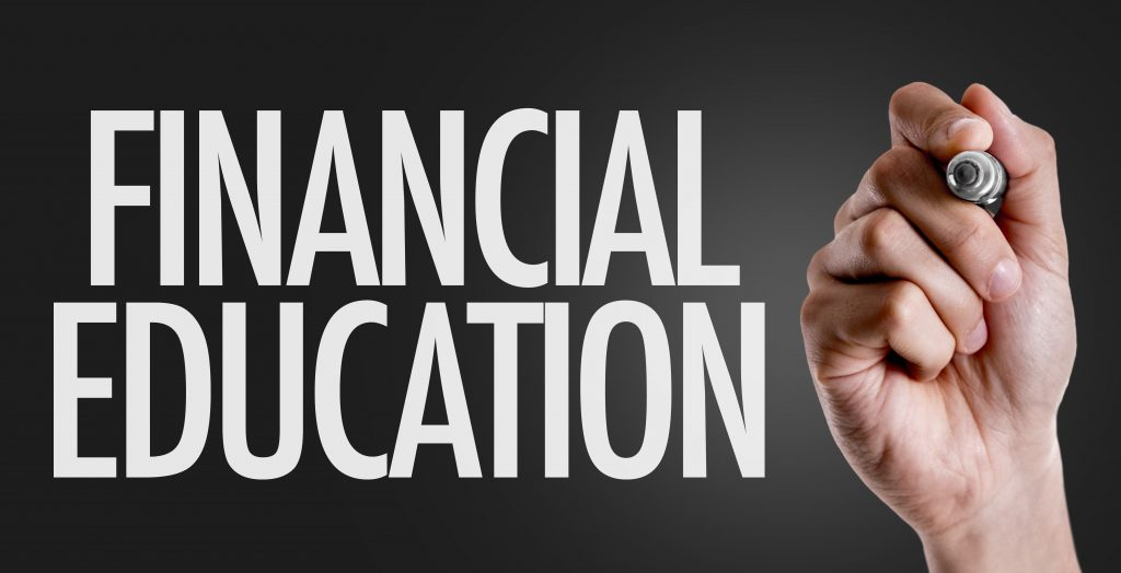 Hand writing the text: Financial Education