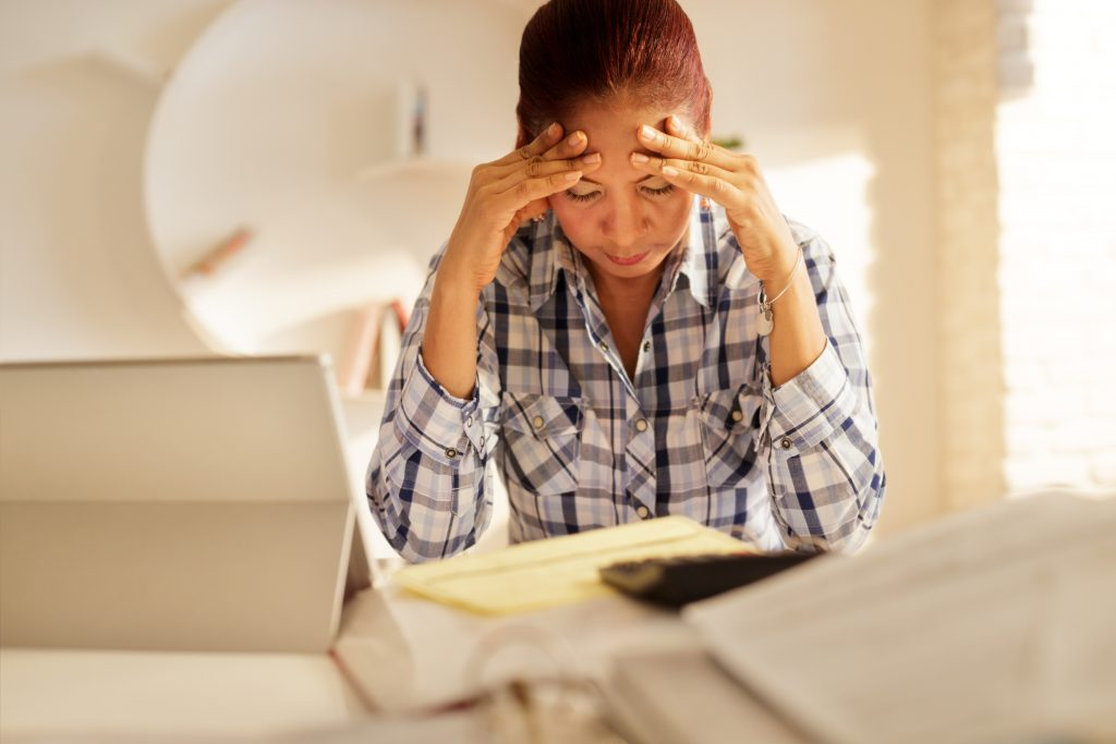 Frustrated Senior Woman Paying Bills And Filing Federal Tax Return